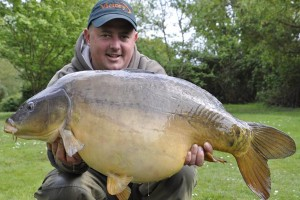 Evolution Team Member Jason Bell holding a large carp